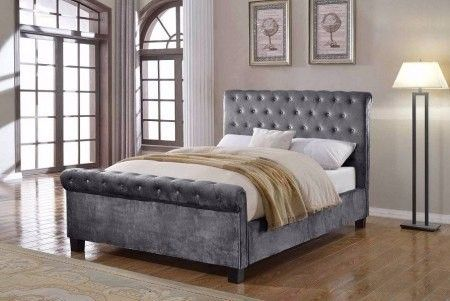 Flair Furnishings Lola Fabric Bedframe Silver Double (4'6) - The Lola Fabric Bed Frame consists of a modern, sleigh style design with a cushioned and buttoned headboard which gives the bed frame a luxurious feel. This bed frame is available in a striking silver velour fabric, sure to catch the eye and be the focal point of any bedroom.