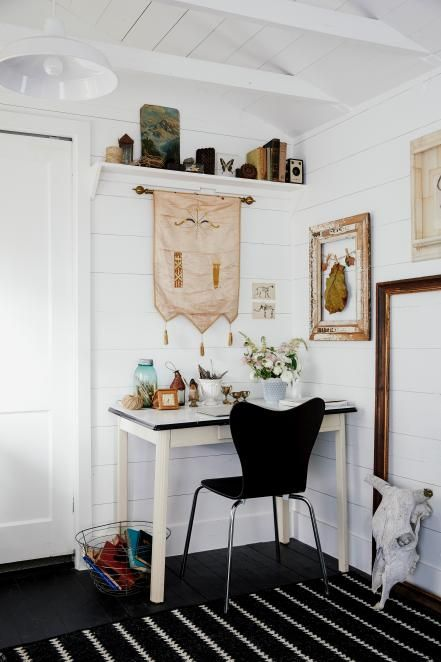HGTV presents a tiny cottage-style cabin that makes great use of available space and features nature-themed eclectic decor such as a framed leaf and a hanging stick.