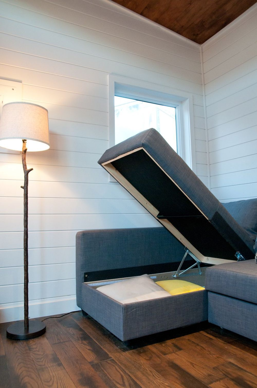 Sofa storage in a tiny house.