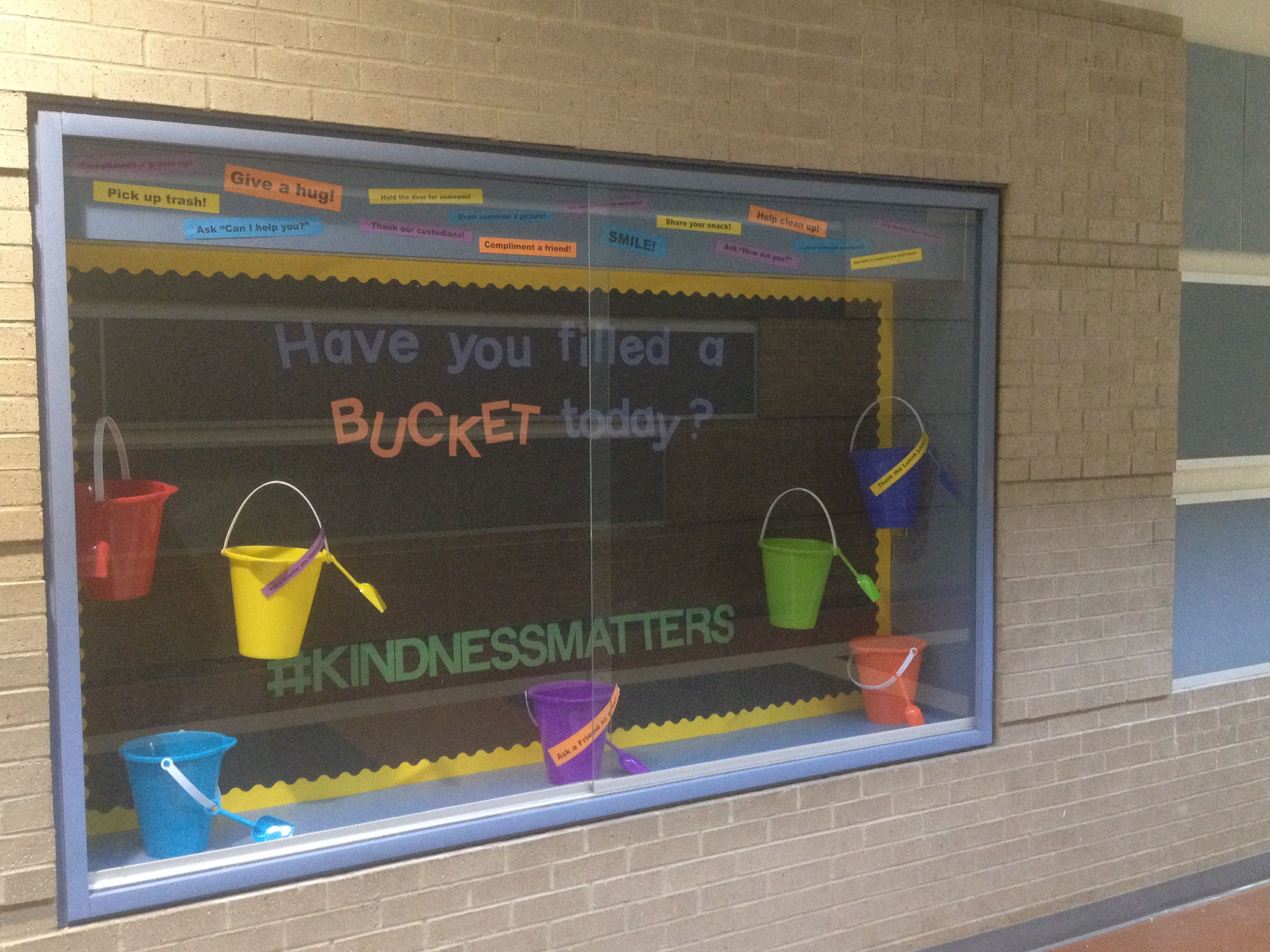 Fill a bucket display case for our foyer! KindnessMatters