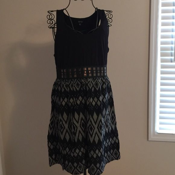 Black and print elastic waist dress Solid cotton top, elastic grommet waist and light weight print bottom dress. Grommets only in front. Elastic at waist is thick. Worn a few times. If you are tall this will be on the short side. No trade/PayPal. Apt. 9 Dresses
