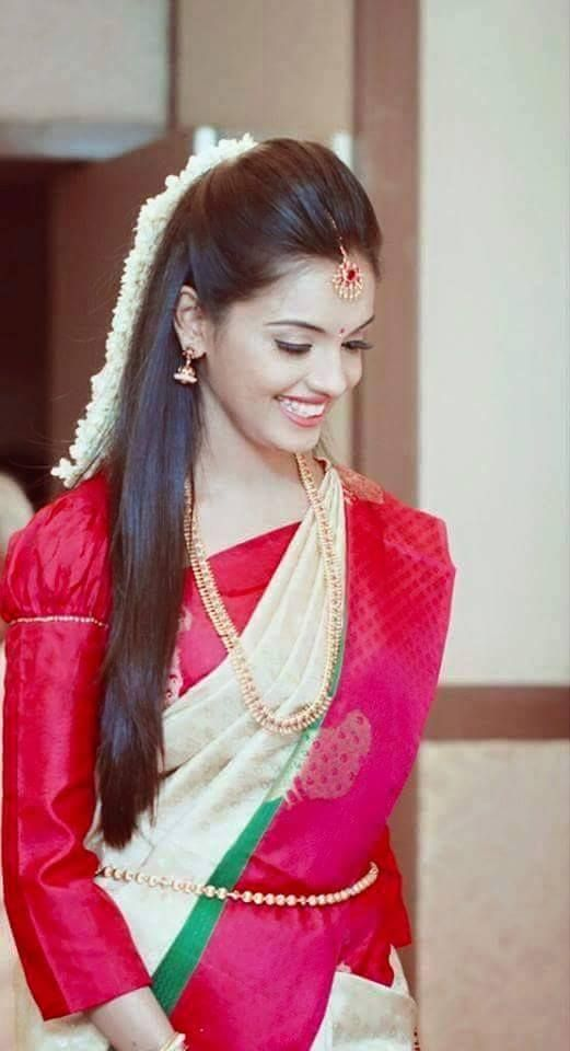 South Indian bride. Temple jewelry. Jhumkis.silk kanchipuram sarees with long sleeve blouse.Half ...