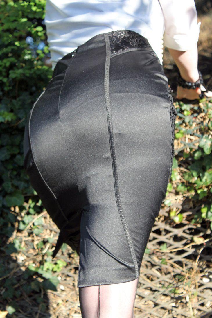 suspender bumps Visible Garter Bumps Under Tight Black Skirt
