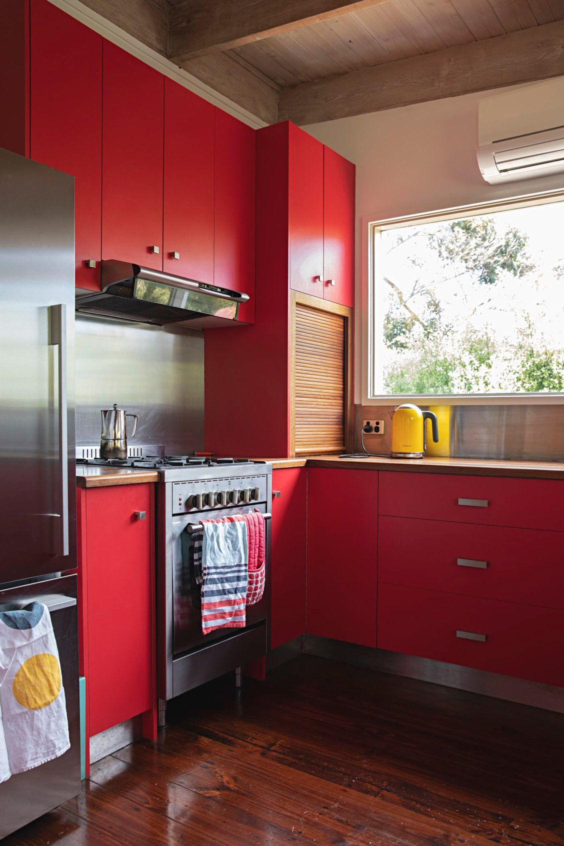 Bird Portraits Abstract Paintings And A Red Kitchen Make For An Incredibly Colorful Australian Home In 2020 Red Kitchen Cabinets Red Kitchen Rustic Kitchen Cabinets