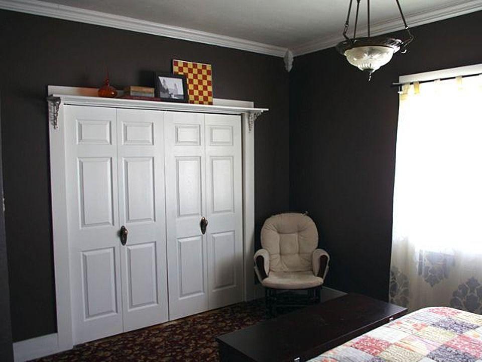 Shelf Over Closet Doors Trophies Knick Knacks Instead Of Hanging Bat