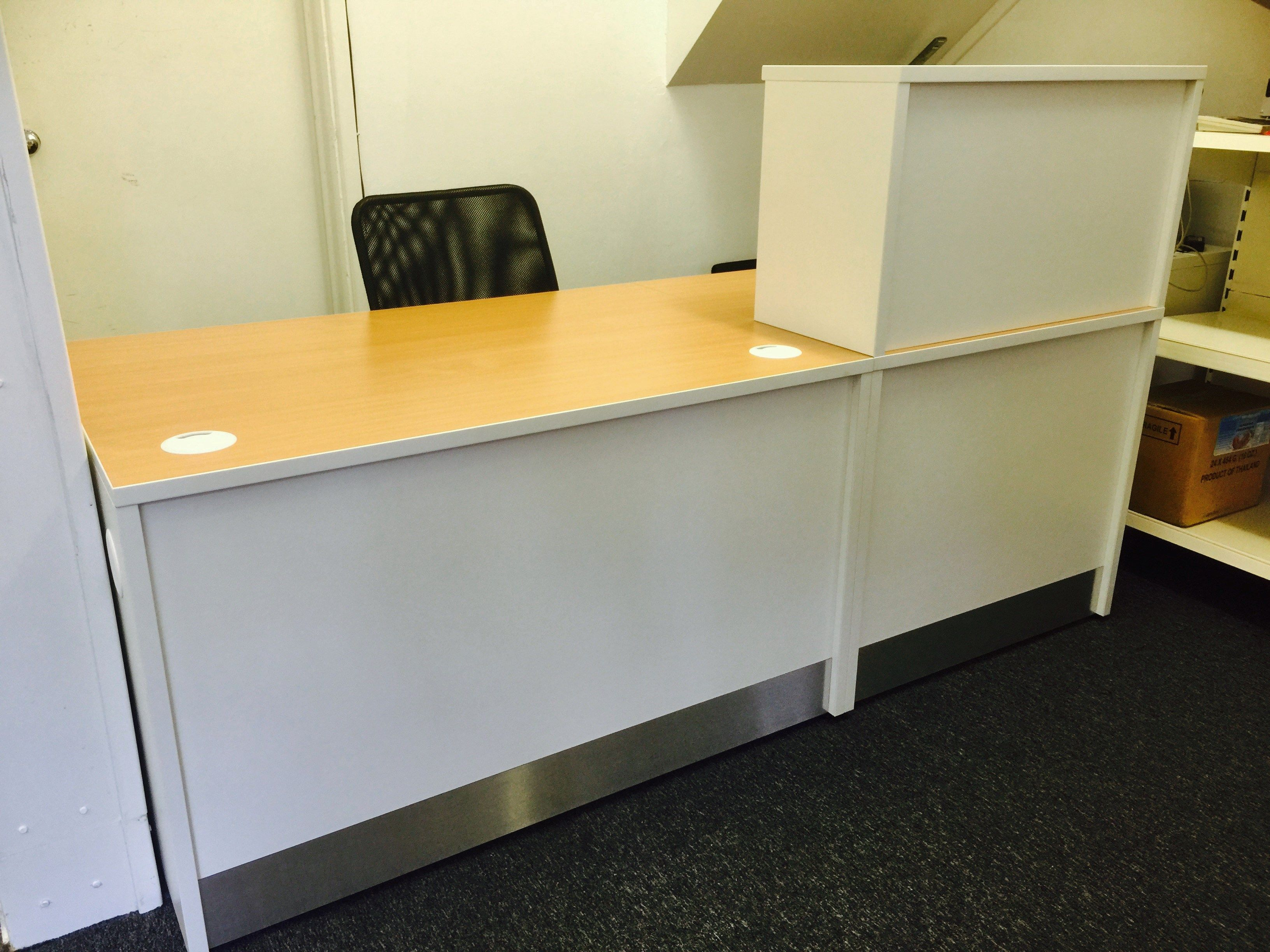 A Small Straight Flex Reception Desk Finished In White With