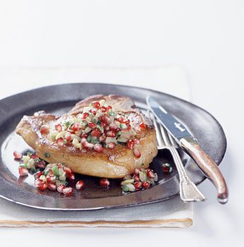 I am not a pork fan but I could eat this everyday.  Its my favorite thing to make to impress although its super easy. Just DON'T OVER COOK THE CHOP!  http://www.epicurious.com/recipes/food/photo/Panfried-Pork-Chops-with-Pomegranate-and-Fennel-Salsa-106055