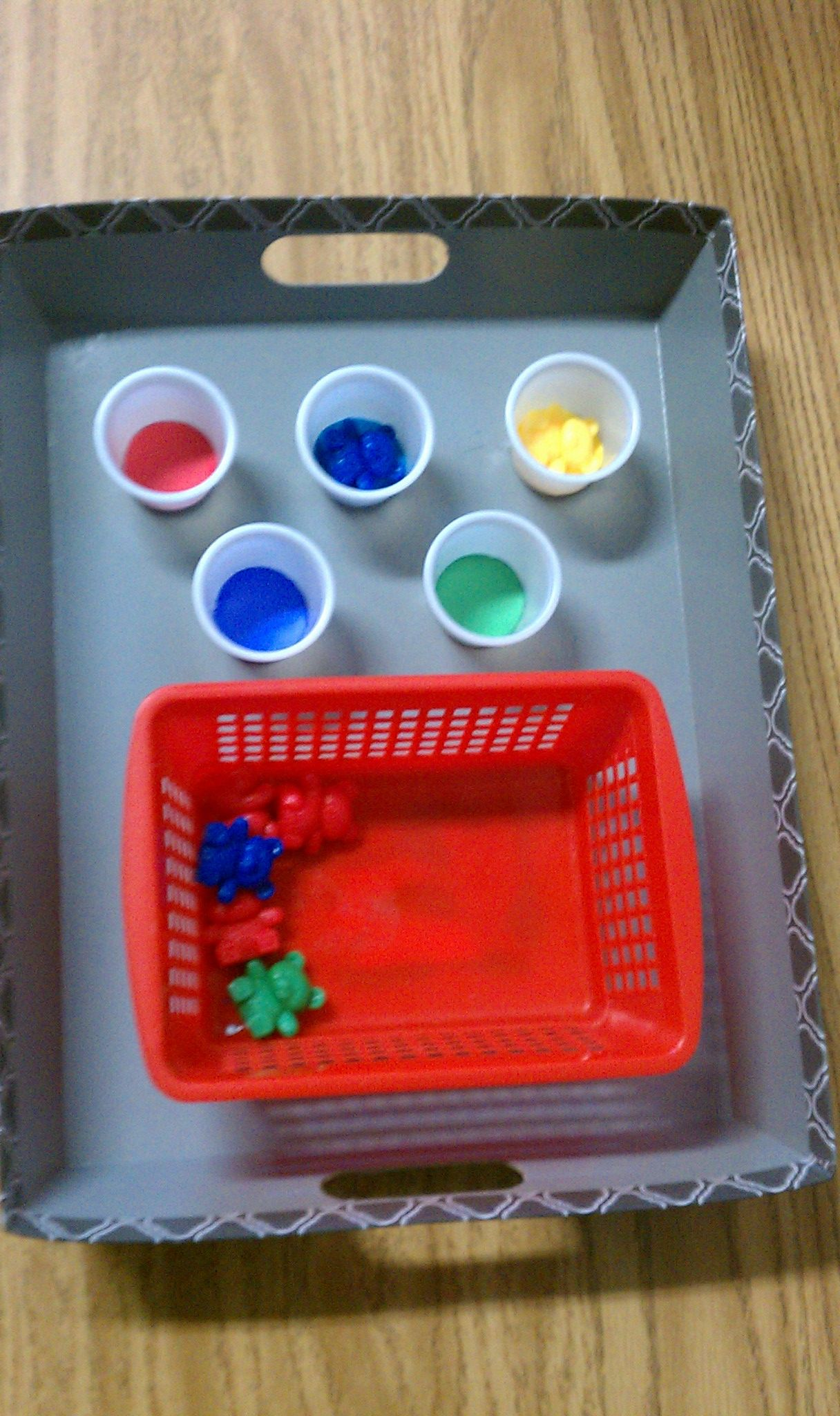 sorting colors: DYI- small cups with colored construction paper inserts glued to cardboard tray (found at dollar store)- colored bears or other small items