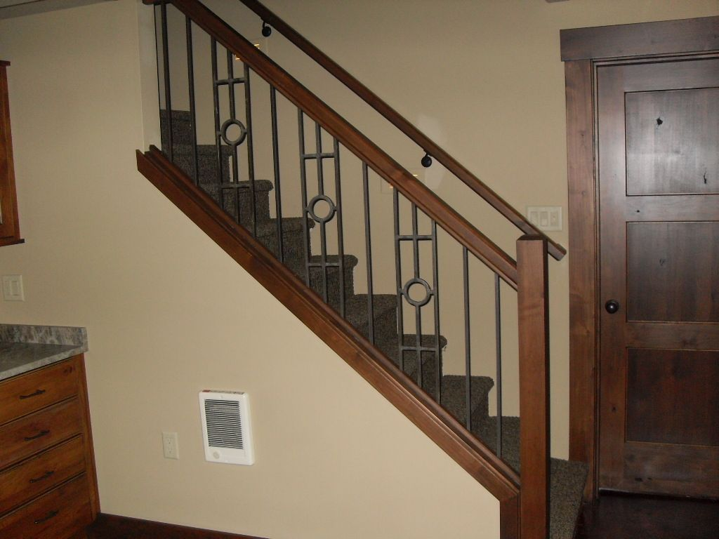Wrought Iron Staircase Panels With Alder Stained Posts