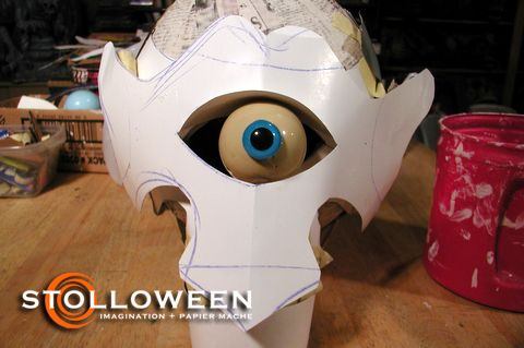 cyclops 3:  Each skull started by adding layers of pm strips to an inflated balloon creating a solid armature or base for the prop. A series of cardboard templates were attached to the pm balloon to achieve the basic facial structure for each Cyclops.