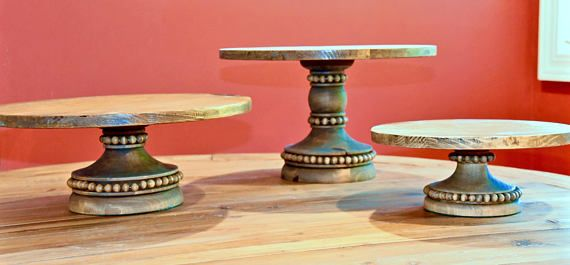 This beautiful Old World Rustic Cake Stand is perfect for your wedding Cake. Many cake stands will not support the weight of a wedding cake and can easily be tipped over. Our stands are design with a wide bottom base to prevent any unhappy mishaps. They are custom lathed to our specifications not generic wooden parts screwed and glued together. Choose a 12 or 14 tops for this extra tall base to make a 9 1/2 inch tall stand.  The tops are detachable. Each has a heavy metal screw nut on th...