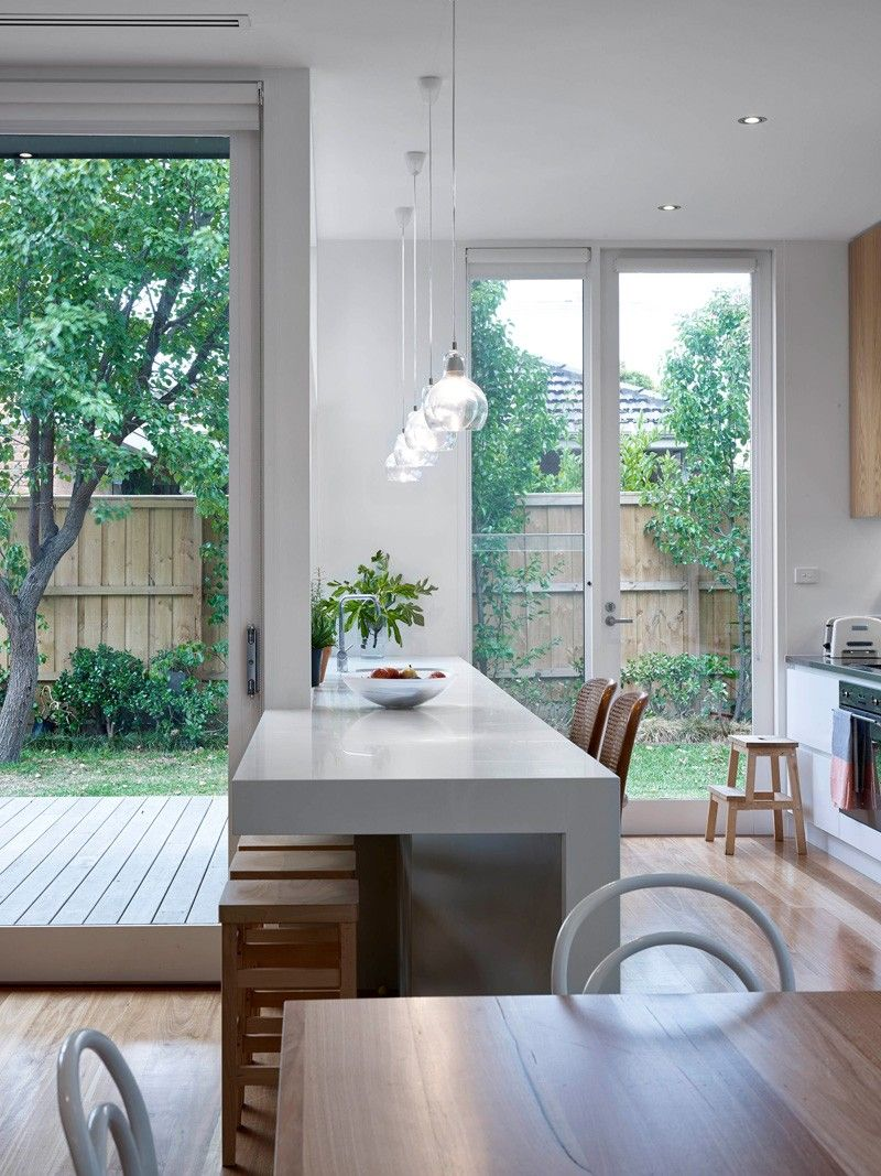 Northcote residence kitchen has  back door and servery window onto outdoor entertaining space also timber clad extension contrasts but considers its edwardian roots rh pinterest