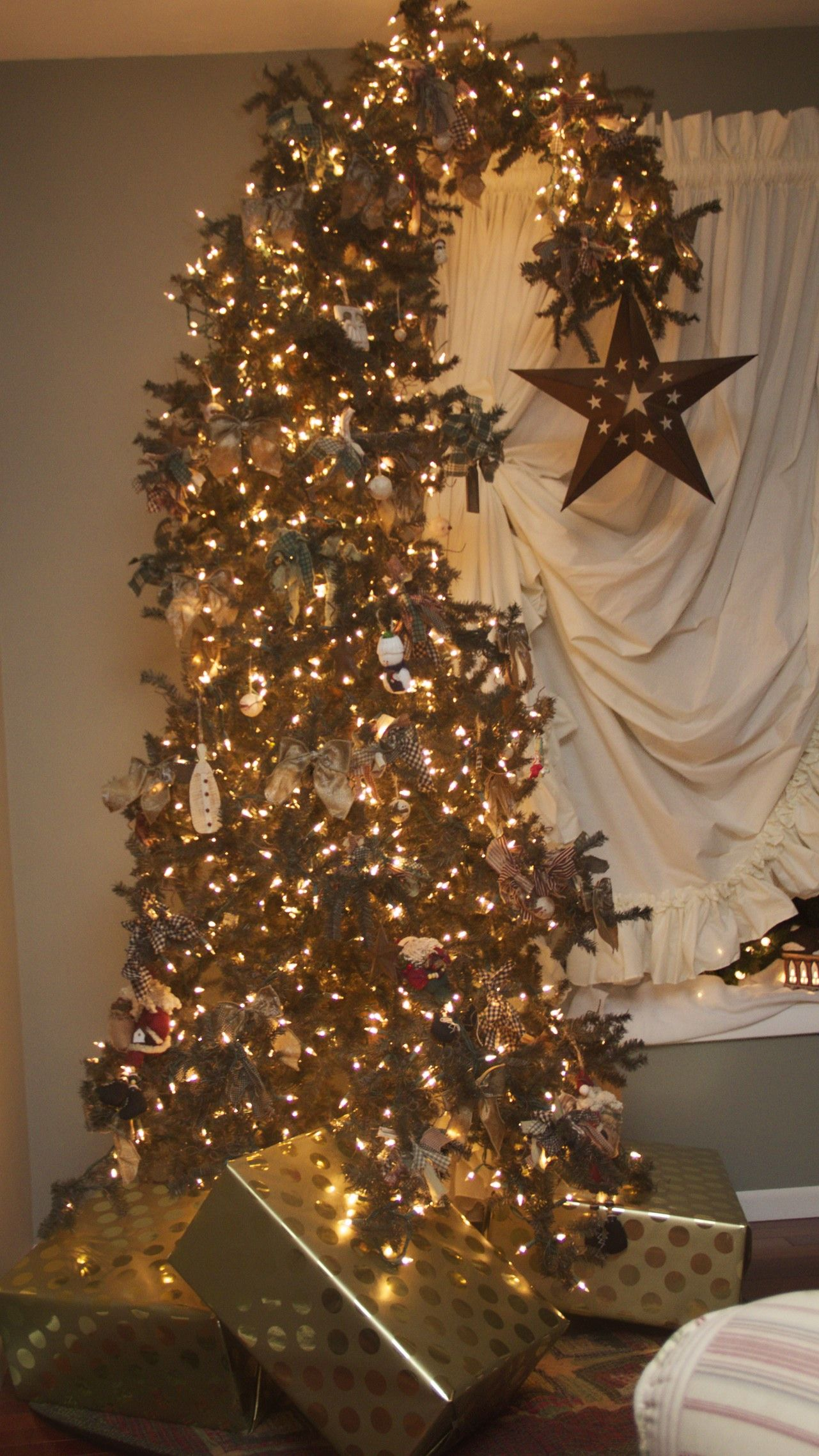 The Leaning Christmas Tree The Story Behind The Tree My Tree Caught A Falling Star Boho Christmas Tree Christmas Tree Outdoor Christmas Decorations