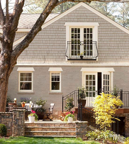 Make The Most Of Your Small Outdoor Spaces Painted Brick House Exterior Brick Exterior Gray Paint