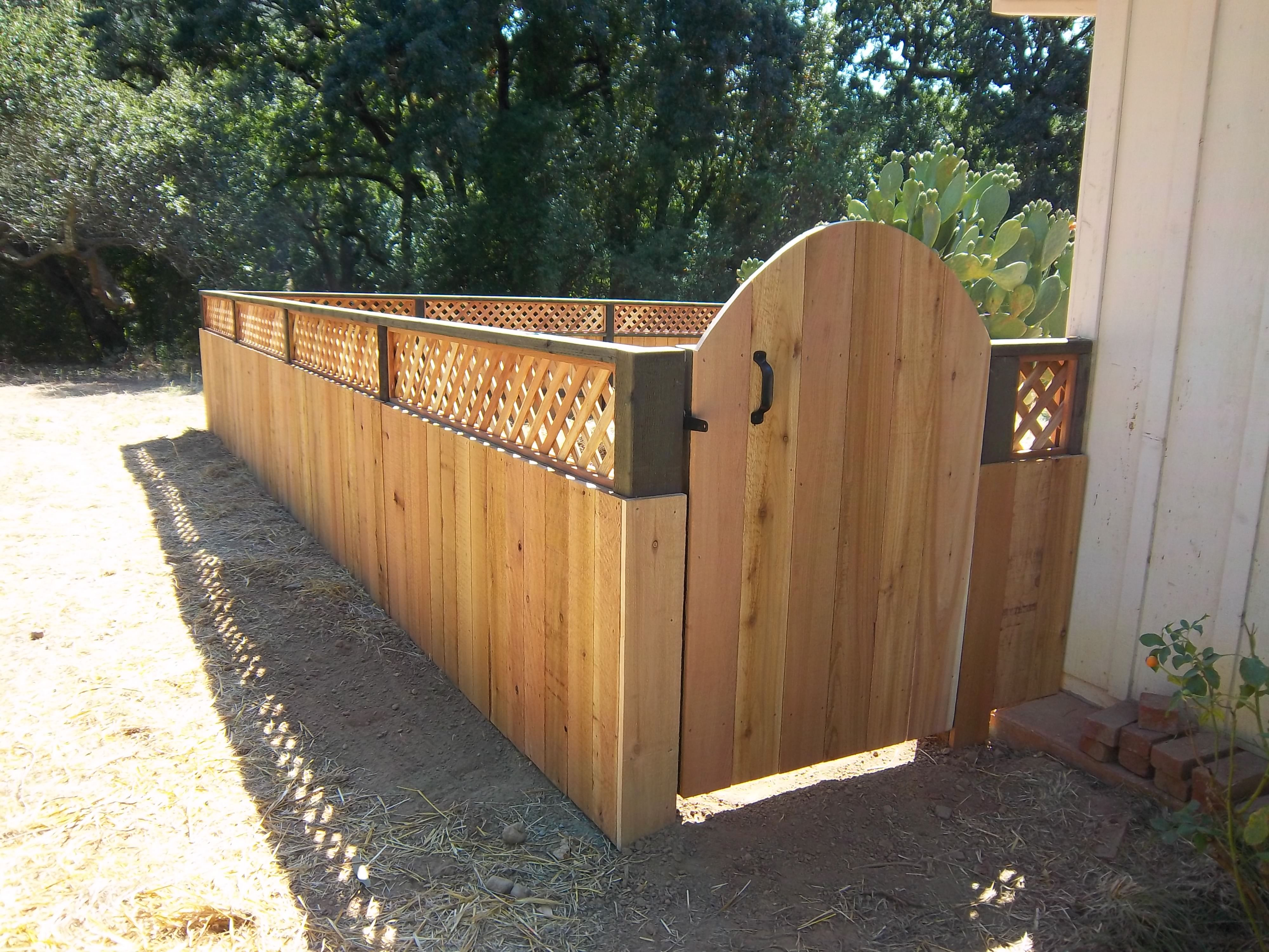 Short wood fence with arched gate solid fences