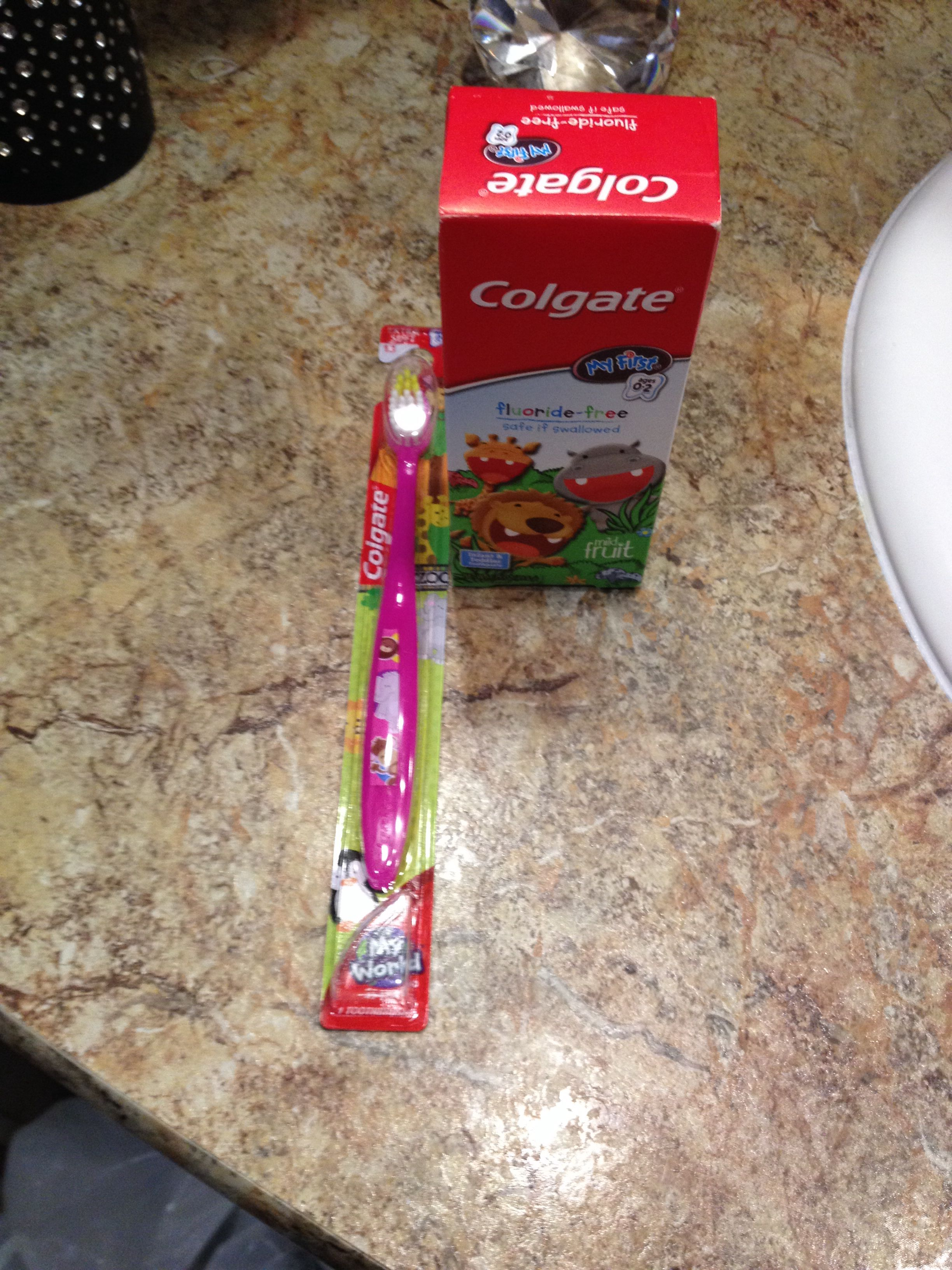 Aww my baby's first tooth brush and tooth paste she's gettin to be such a big girl