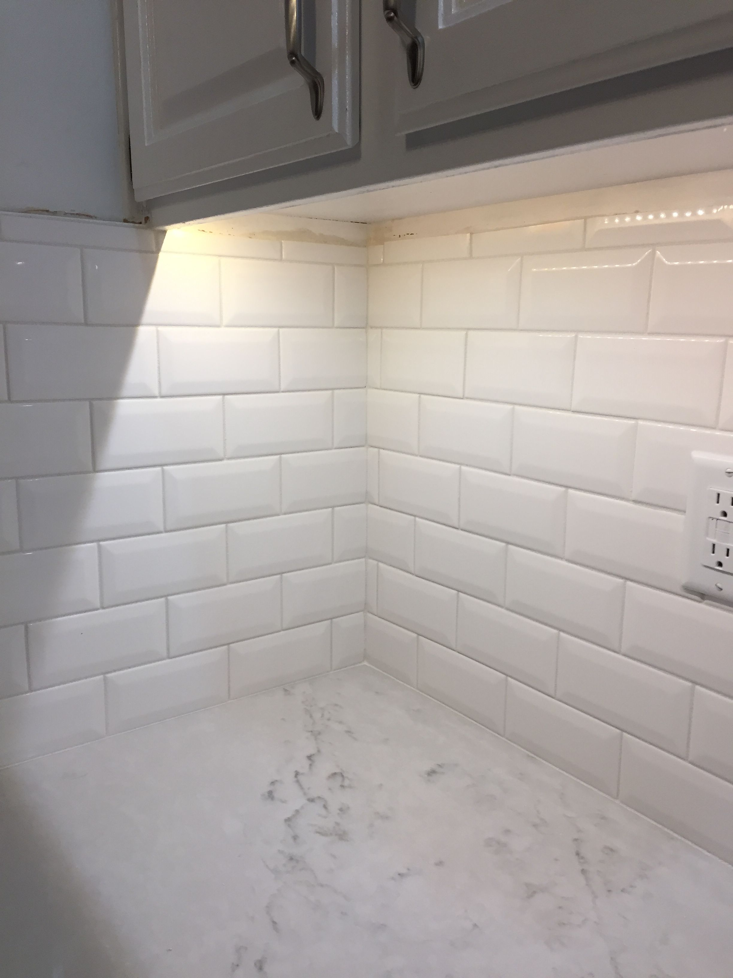 - The Beveled White Subway Tile Enlarges The Space To Make The