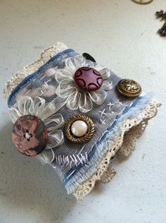 Denim and lace shabby vintage button cuff bracelet on Etsy, £9.89