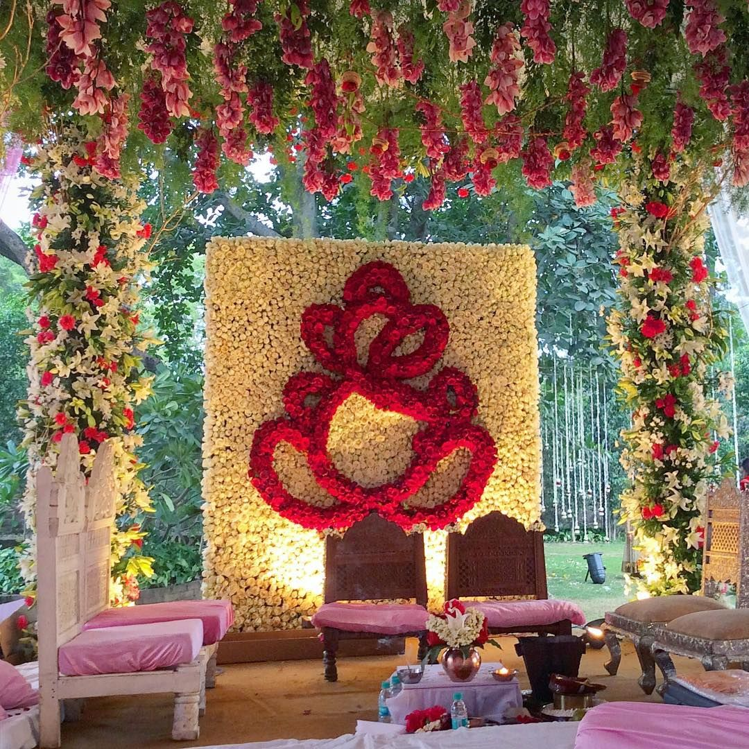 Flowers Decoration For Home: Love This Red Floral Ganesh Decor Under A Floral Mandap At