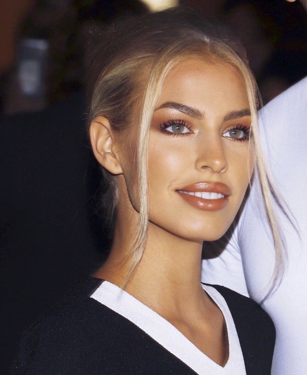 stunning 90s super model, blond, perfect teeth with warm tone makeup, copper lip and eyeshadow