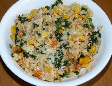 Whole grain sorghum pilaf with toasted corn with Parmesan cheese on top.