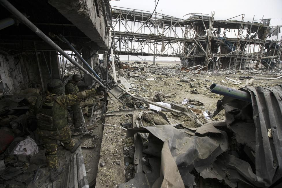 Two armed men of the separatist self-proclaimed Donetsk People's Republic army are seen in the Donetsk airport, damaged by months of fighting, February 26, 2015. REUTERS/Baz Ratner