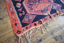 bright rug, light wood