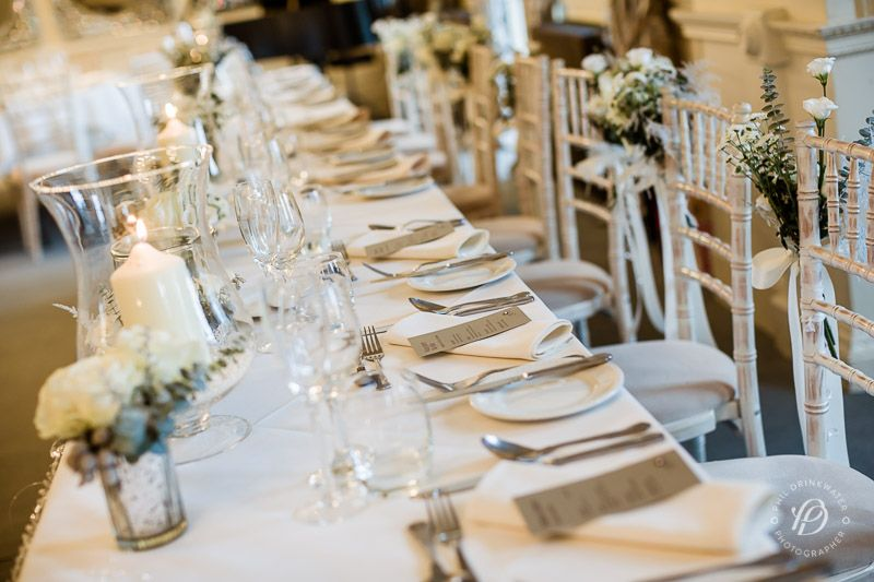 winter wedding flowers top table decoration chair flowers eaves hall wedding flowers by laurel weddings photography by phil drinkwater