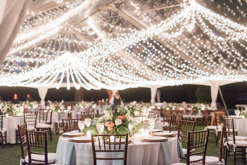 20 Romantic Wedding Lighting Ideas To Make You Swoon Tent Wedding Reception Wedding Reception Seating Arrangement Wedding Lights