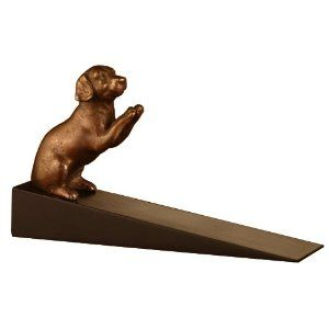 "Labrador Doorstop by SPI. $17.95. Bronze finish. 3.5""H 6.5""W 2""D. Brass & Wood. Black base. This darling Labrador retriever would love to run and play with you, but he is too busy with your door! This doorstop measures 3.5 inches high, 6.5 inches wide, and 1.5 inches deep. The wedge-shaped wood base holds that door in place, and the felt bottom helps prevent skidding and slipping. The Aardvark does have a tennis ball with him, just in case. Imported."
