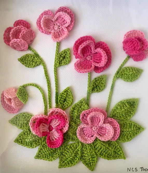 Crocheted pink pansies in box frame wall art