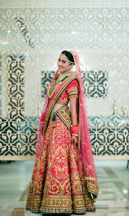 6a1c03e65c Real Indian Weddings - Gunjan and Shant | WedMeGood | Coral and Gold  Embroidered Lehenga with Bottle Green Detailing #wedmegood #realwedding # coral