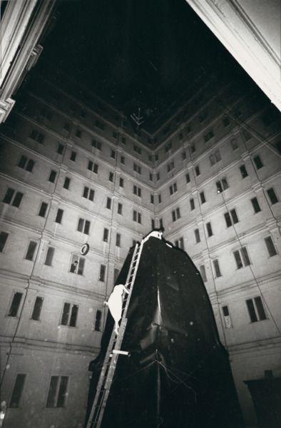 lettie eisenhauer ascending ladder in the courtyard