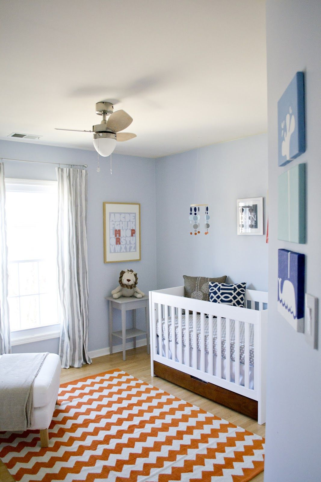 Navy And Light Blue Nursery With A Touch Of Bright Color
