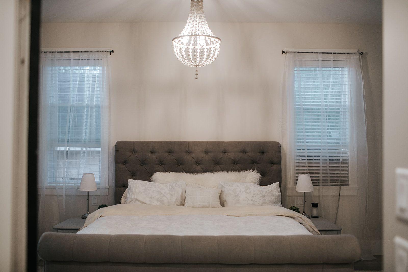 Restoration hardware lighting. Upholstered grey bed. Sheer