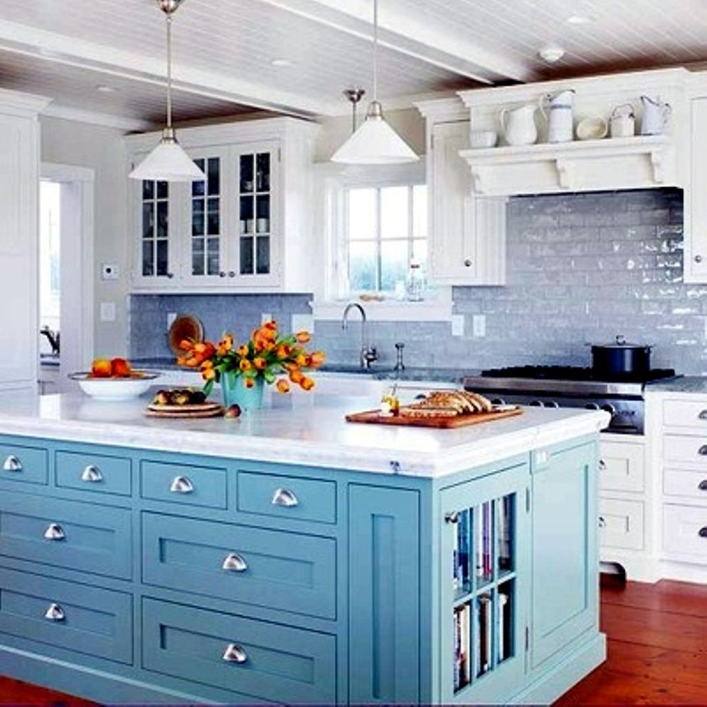 Soft Blue Kitchen Island With White Countertop And