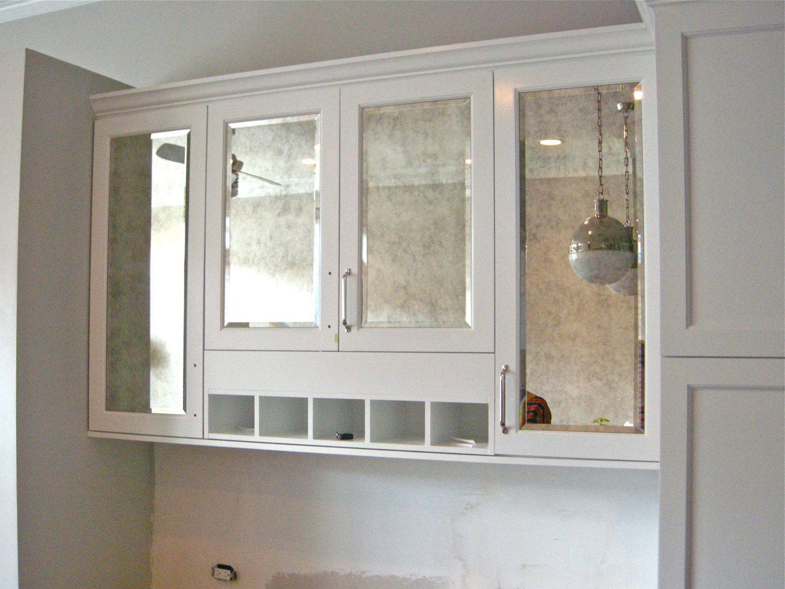 Do antiqued mirror insets on doors that go from ceiling to surface ...