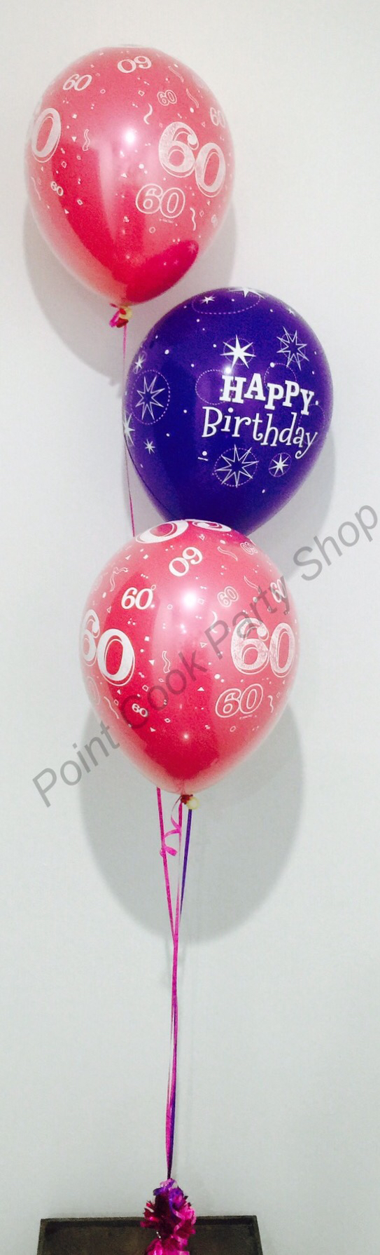60th birthday balloon bouquet. Hot pink and purple balloons set up ...