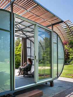 House Arc - made from 90% recyclable lightweight steel, designed to be off-grid with solar roof and large windows, several units can be placed together to create larger structure