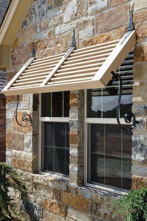 Bermuda shutter on stone wall with iron detailing | Beacon ...