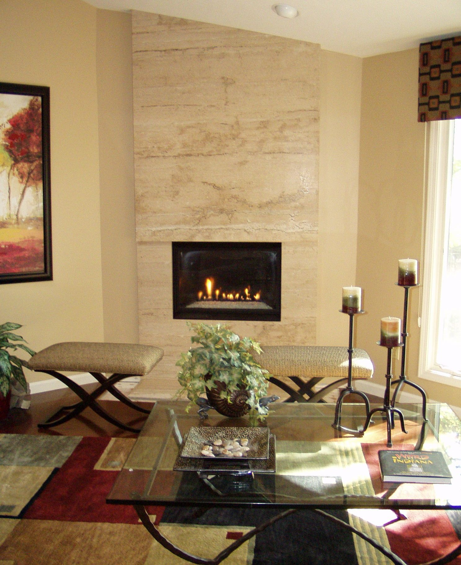 Floor to ceiling travertine fireplace that creates a dramatic focal ...
