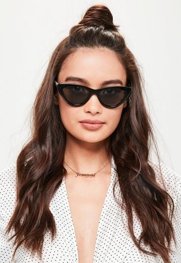Black sunglasses featuring a cat eye frame and tonal lenses. | My ...