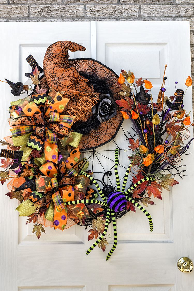 """This Halloween/Fall Wreath features: 3D Spider, Witch Hat and """"Terri Bows."""" All made with wire ribbon on PROBOWTHEHAND"""