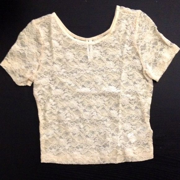 Floral crop top Cream-colored crop top with a sheer floral pattern.  Tight-fitting.  Only worn once and in great condition Forever 21 Tops Crop Tops