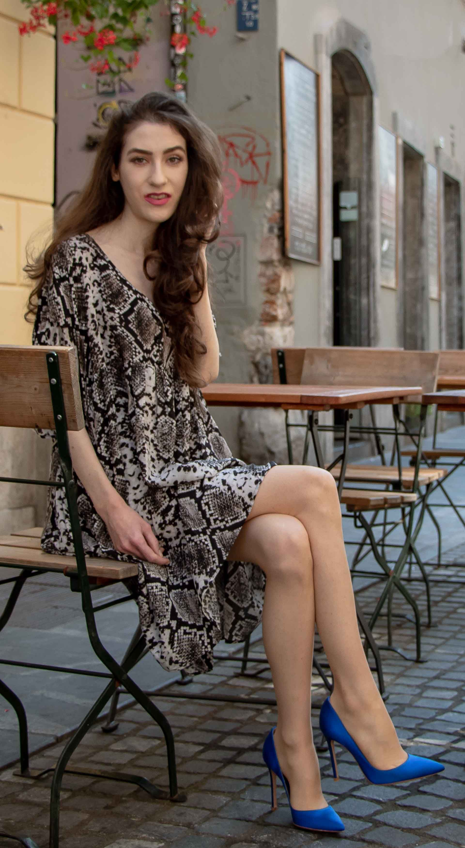 dab6126792ca Fashion Blogger Veronika Lipar of Brunette from Wall Street sharing how to  wear snake print dress