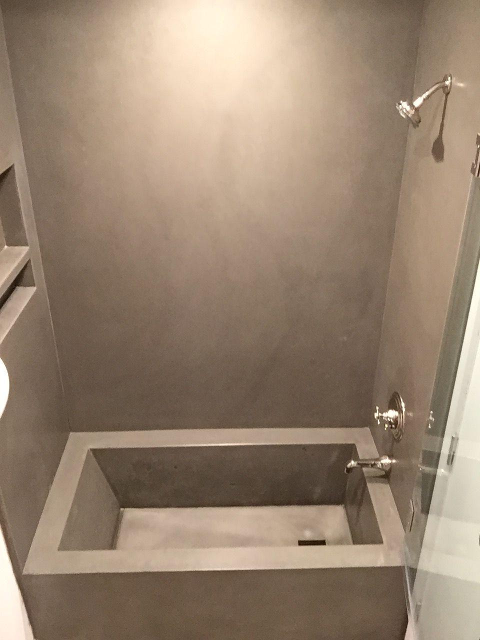 custom concrete bathtub, wall panels with niche. www ...