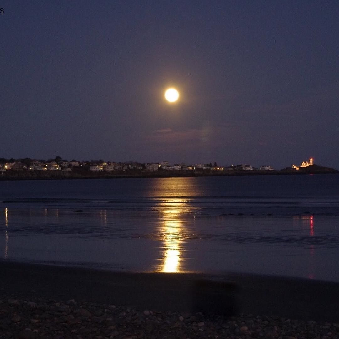 Moonrise over York Maine Long Sands Beach. The Nubble lighthouse ...