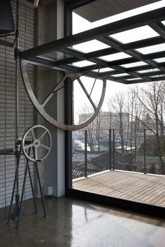 This Steel Door Pivots Open Horizontally By Means Of A Manual Winch Industrial House Steel Door Design Architecture Design