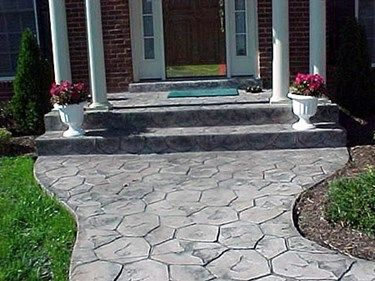 Decorative concrete walkway designs for colonial style homes