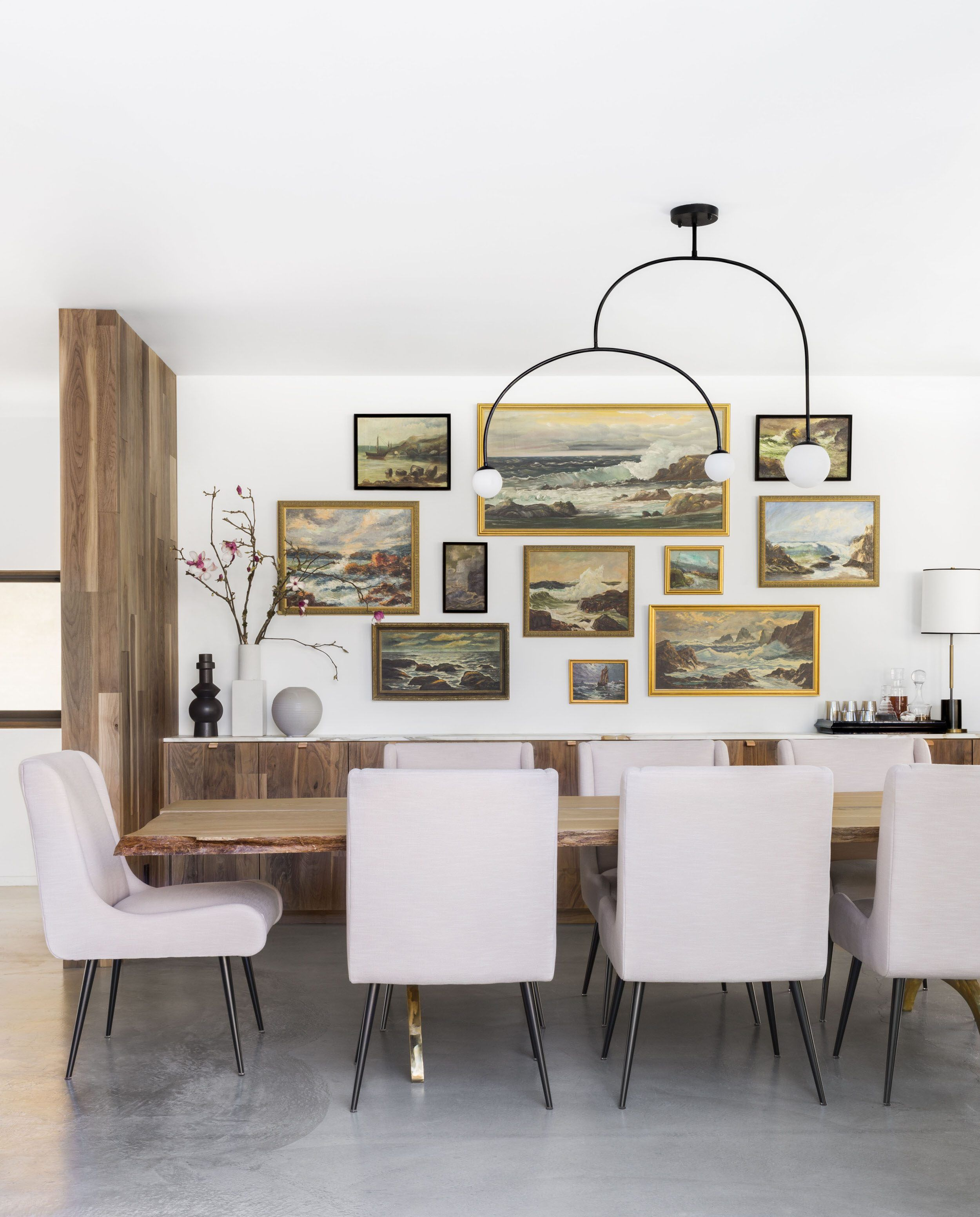 A Modern And Organic Dining Room Makeover I Really Like This Wall Of Assorted Ocean Seascapes Those Chairs Also